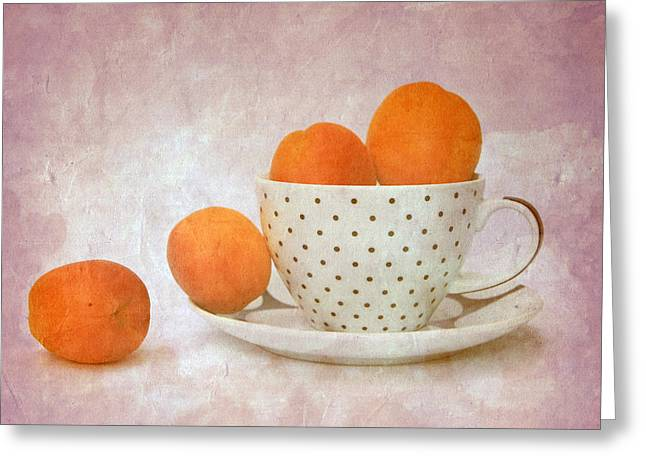 Apricots In A Cup Greeting Card by Angela Bruno
