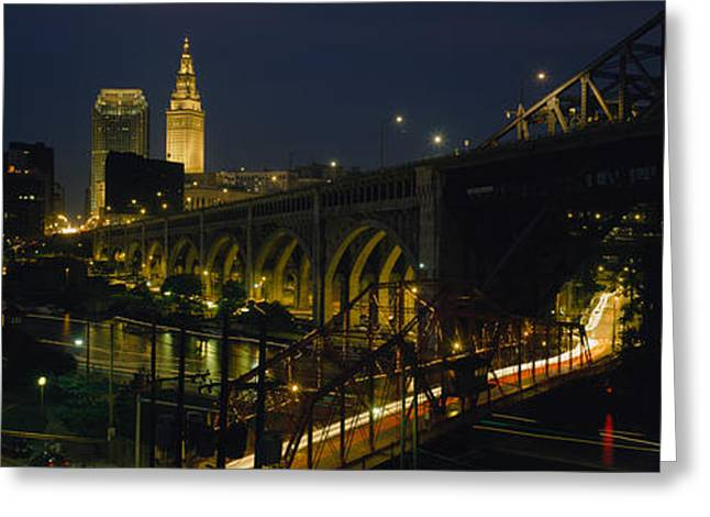 Arch Bridge And Buildings Lit Greeting Card by Panoramic Images