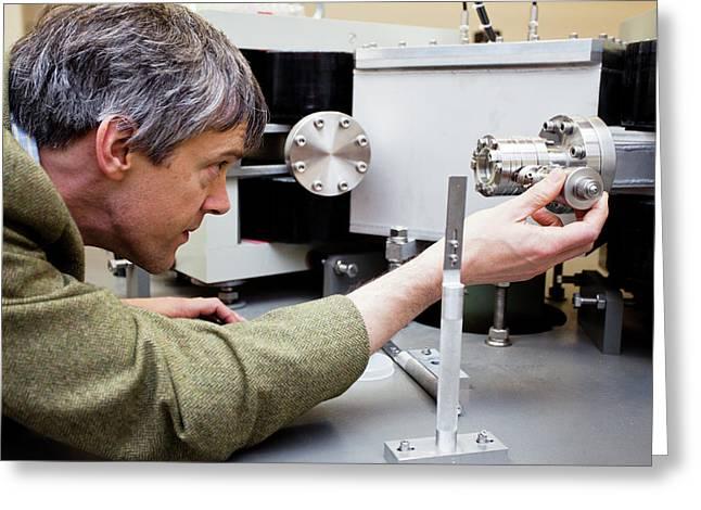 Archaeologist Adjusting Lab Equipment Greeting Card by Pawel Sytniewski/oxford University Images