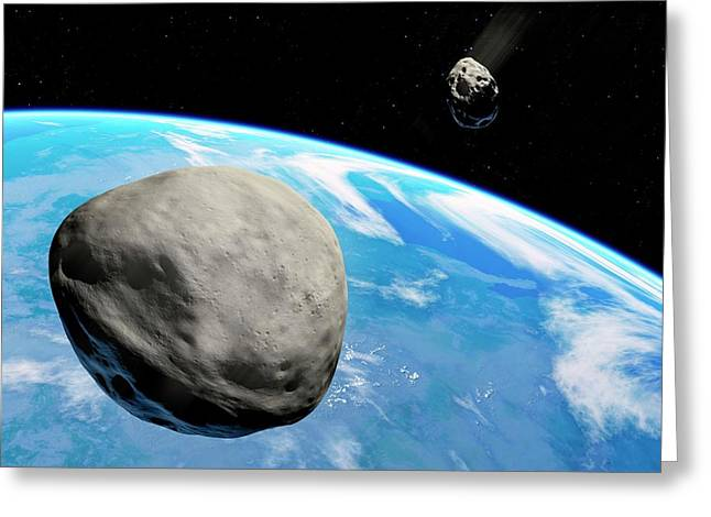 Asteroids Approaching Earth Greeting Card by Detlev Van Ravenswaay