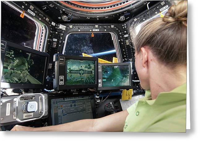 Astronaut In Iss Robotics Workstation Greeting Card