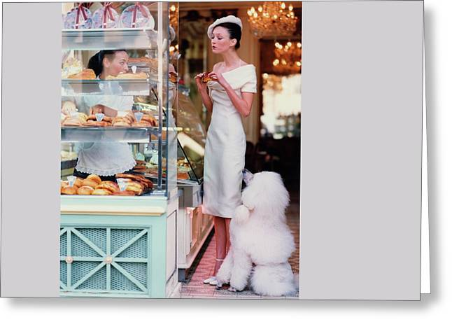 Audrey Marnay At A Patisserie With A Poodle Greeting Card by Arthur Elgort