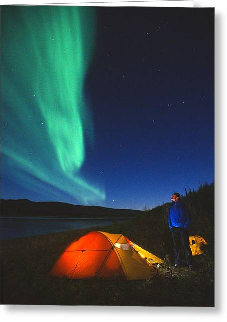 Aurora Borealis Above A Tent And Camper Greeting Card by Peter Mather