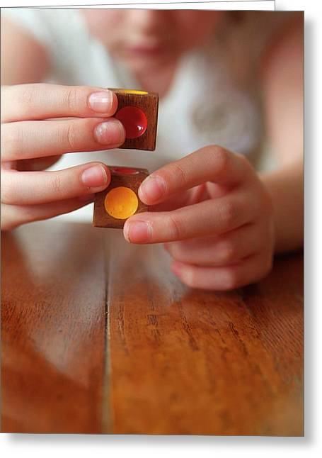 Autistic Girl Playing With Toy Blocks Greeting Card by Hannah Gal