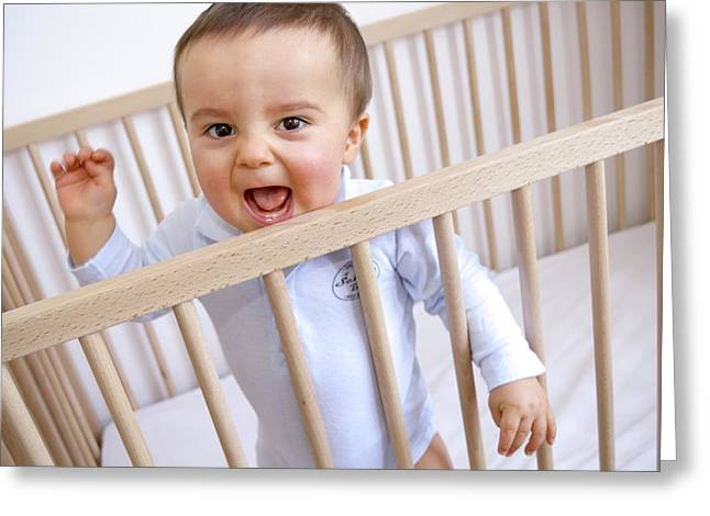 Baby Boy In His Cot Greeting Card