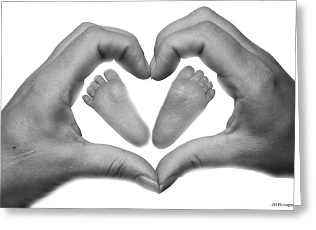 Baby Feet In Mothers Hand Greeting Card by Jay Harrison