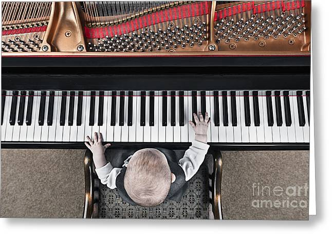 Baby Pianist Greeting Card by Justin Paget