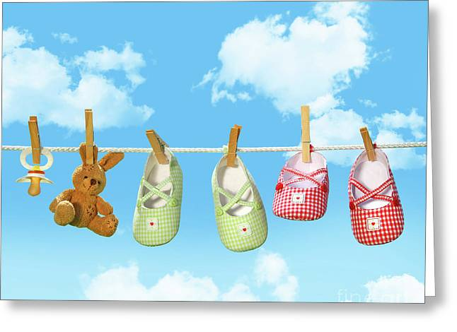 Baby Shoes And Teddy Bear On Clothline Greeting Card by Sandra Cunningham