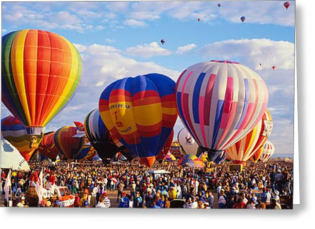 Balloons Being Launched Greeting Card by Panoramic Images