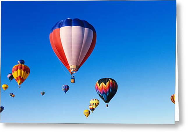 Balloons Floating In Blue Sky Greeting Card by Panoramic Images