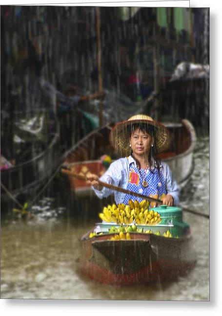 Greeting Card featuring the photograph Banana Vendor In The Rain by Rob Tullis