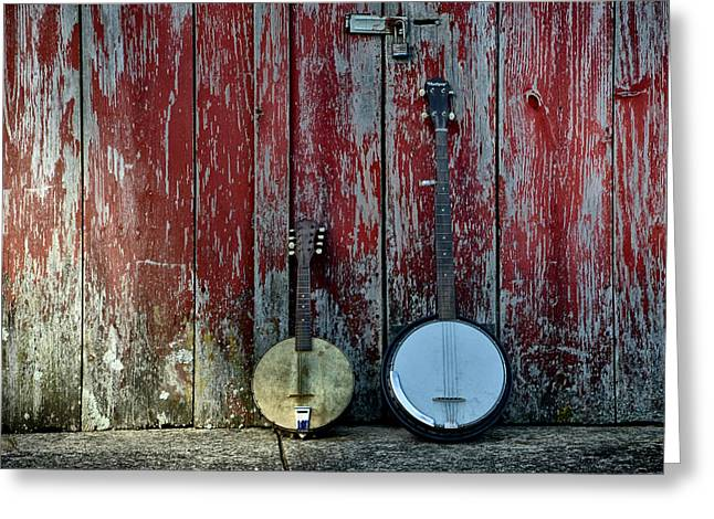 Banjos Against A Barn Door Greeting Card by Bill Cannon