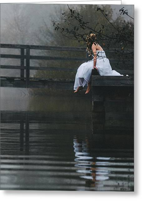 Barefoot Bride In White Wedding Dress Sitting On A Jetty At A La Greeting Card by Leander Nardin