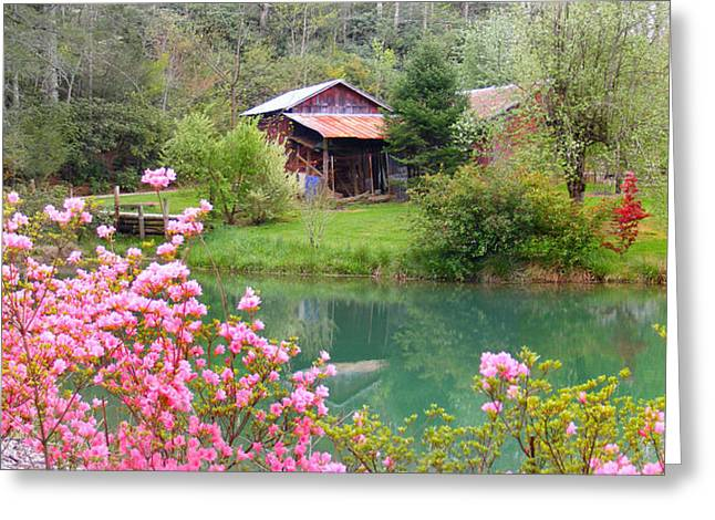 Barn And Flowers Near Pond Greeting Card