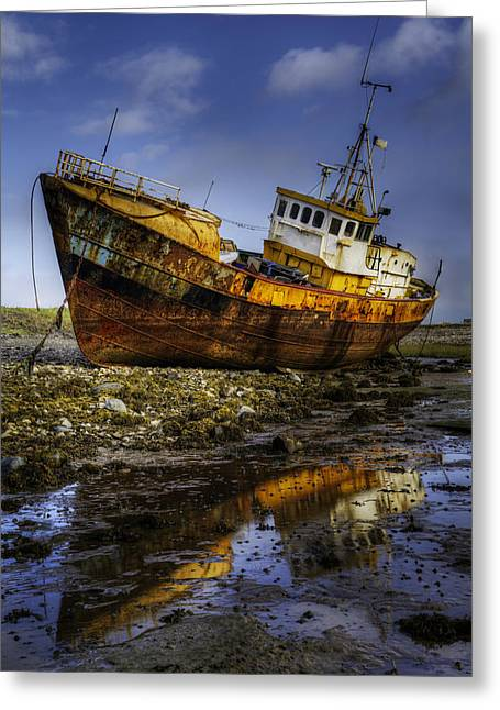 Greeting Card featuring the photograph Beached Fishing Trawler Reflecting While Waiting For The Tide by Dennis Dame