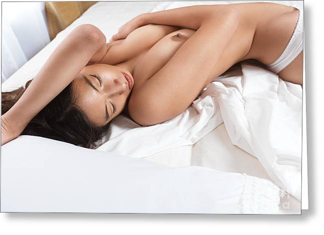 Beautiful Asian Woman Lying On White Bed Sheets Greeting Card by Oleksiy Maksymenko