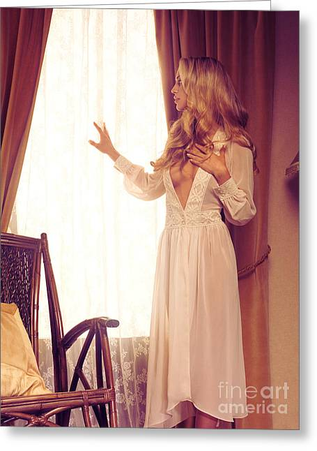 Beautiful Blond Woman In Night Gown Looking Out Of The Window Greeting Card