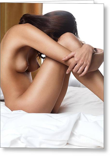 Beautiful Woman Sitting Naked On Bed With Arms Around Her Knees Greeting Card