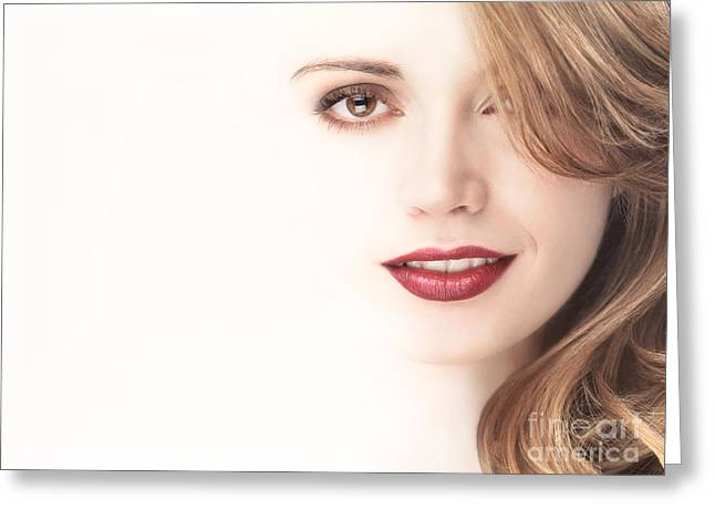 Beautiful Young Woman Face Blending Into Light Background Greeting Card by Oleksiy Maksymenko