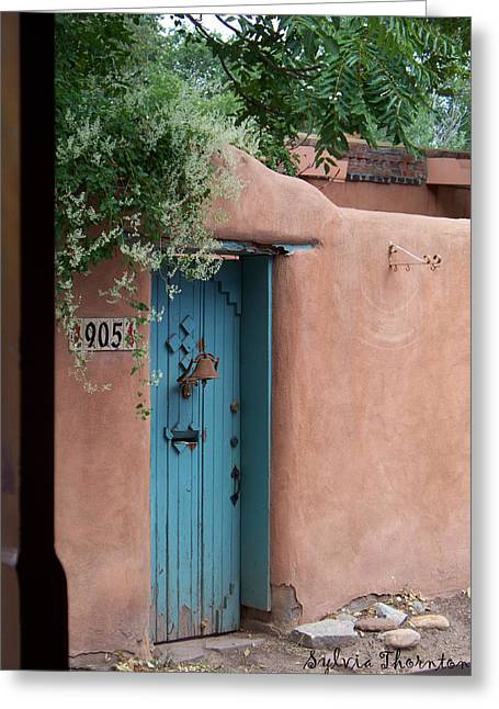 Greeting Card featuring the photograph Behind The Blue Door by Sylvia Thornton