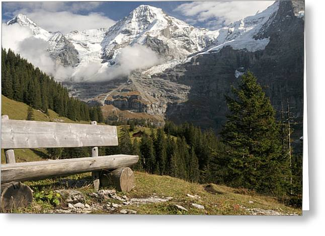 Bench With Mt Eiger And Mt Monch Greeting Card by Panoramic Images