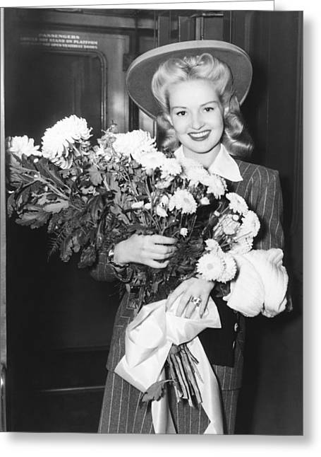 Betty Grable With Flowers Greeting Card by Underwood Archives