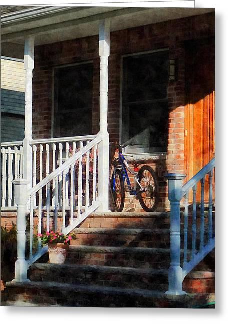 Bicycle On Porch Greeting Card by Susan Savad
