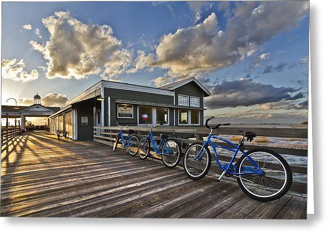 Bicycles On The Dock Greeting Card by Debra and Dave Vanderlaan