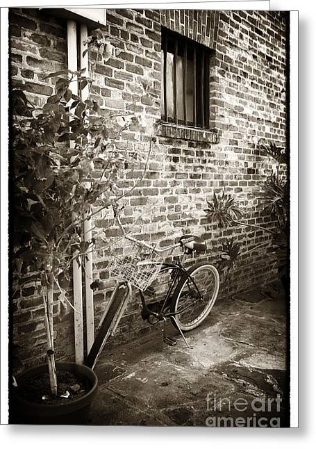 Bike In Pirates Alley Greeting Card by John Rizzuto