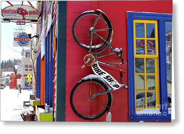 Bike Shop Greeting Card by Fiona Kennard