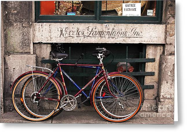 Bikes In Old Montreal Greeting Card by John Rizzuto