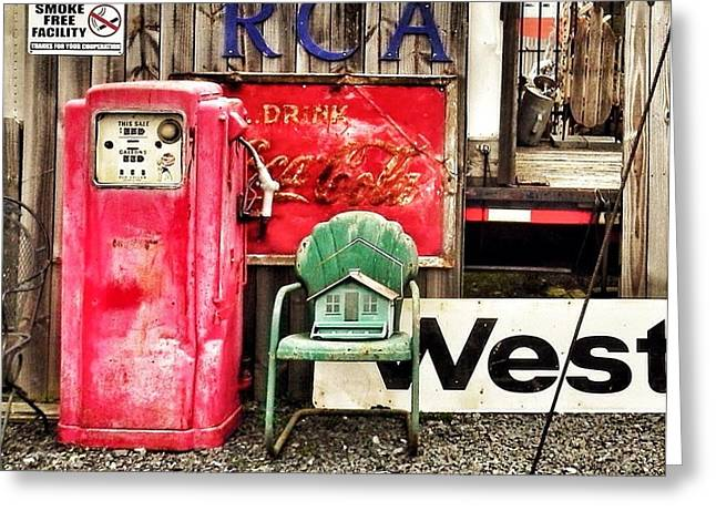 Birdhouse On A Chair By A Gas Pump Greeting Card by Patricia Greer