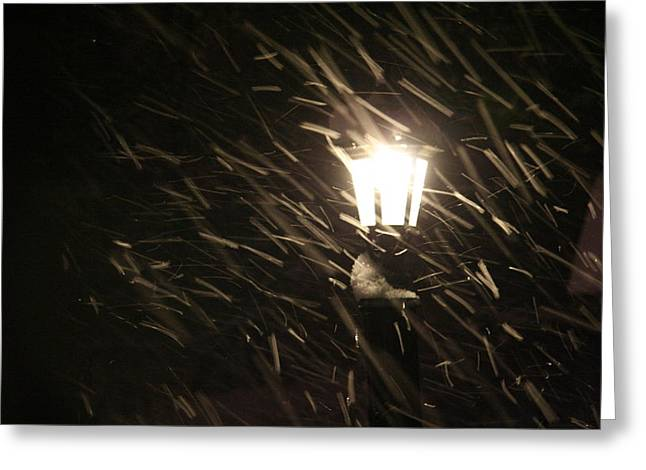 Blowing Snow Against Lamp Greeting Card by Carolyn Reinhart