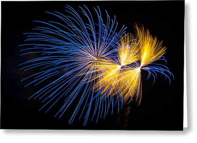 Blue And Orange Fireworks Greeting Card by Paul Freidlund