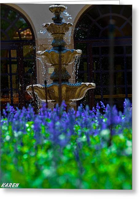 Blue Flowers And A Fountain Greeting Card by Karen Kersey