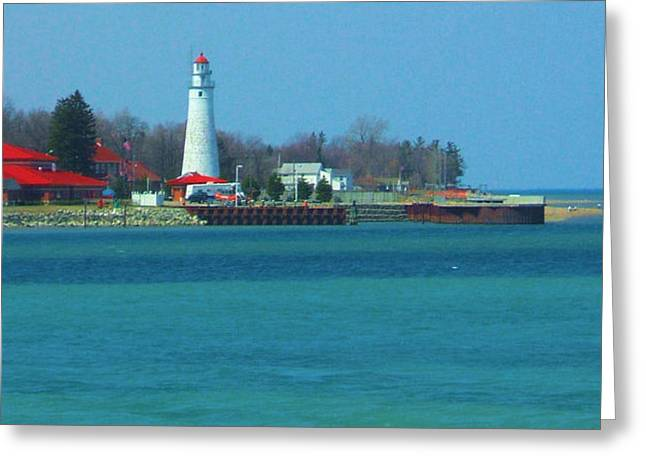 Blue Water Lighthouse Greeting Card by Peg Holmes