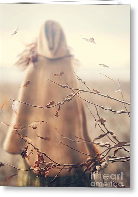 Greeting Card featuring the photograph Blurred Image Of A Woman With Cape by Sandra Cunningham