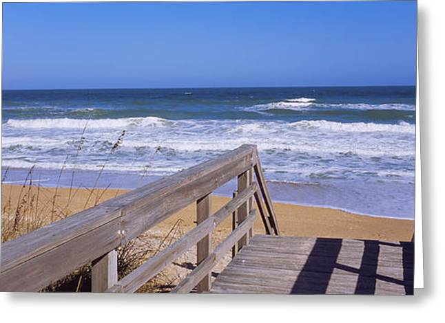 Boardwalk Leading Towards A Beach Greeting Card by Panoramic Images