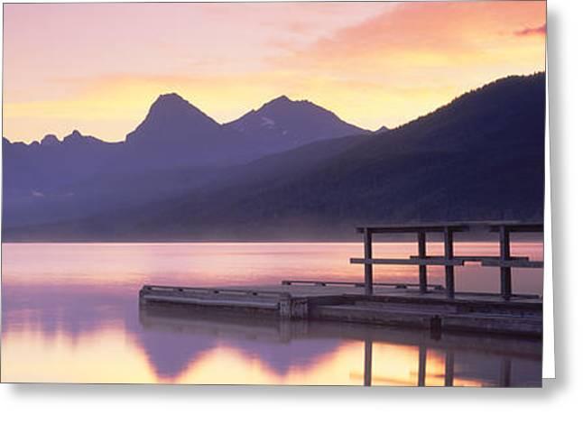 Boat Dock At Lake Mcdonald, Glacier Greeting Card by Panoramic Images