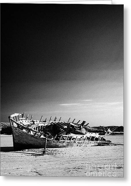 boat wreck on bunbeg beach in gweedore gaeltacht county Donegal eire Republic of Ireland Greeting Card