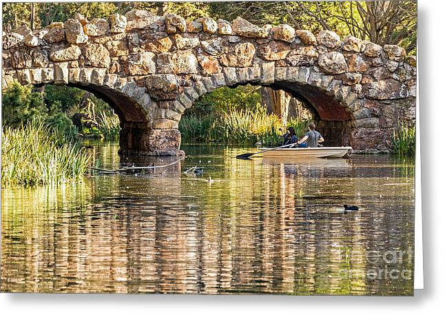 Boaters Under The Bridge Greeting Card