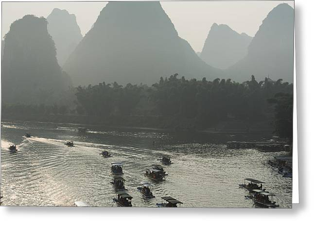 Boats Along The Li River At Sunset Greeting Card by Keith Levit
