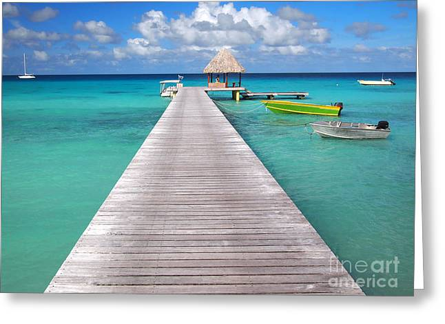 Boats At The Jetty In A Tropical Turquoise Lagoon Greeting Card by IPics Photography