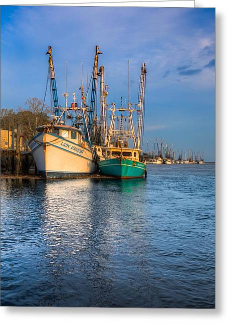 Boats In Blue Greeting Card by Debra and Dave Vanderlaan