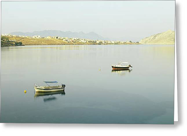 Boats In The Sea With A City Greeting Card by Panoramic Images