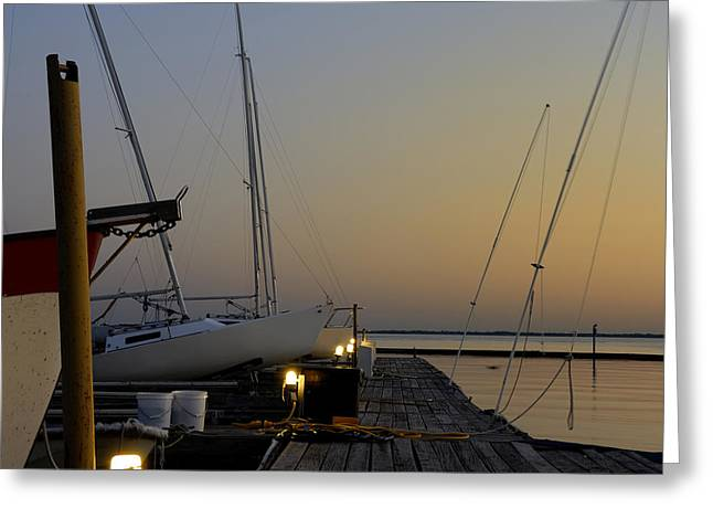 Boats Moored To Pier At Sunset Greeting Card