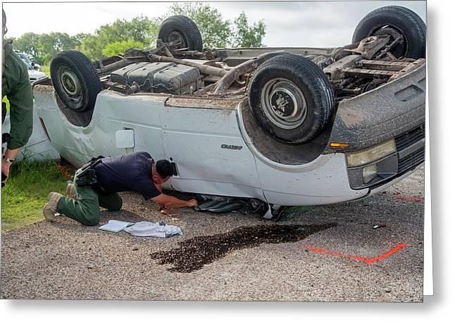 Border Patrol Officer Inspecting A Crash Greeting Card