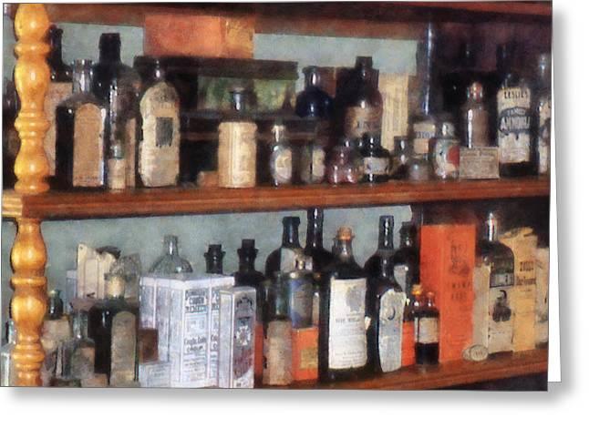 Bottles In General Store Greeting Card by Susan Savad