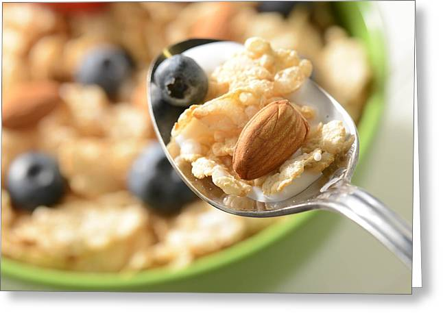 Bowl Of Cereal With Bluberries And Almonds On Spoon Greeting Card by Brandon Bourdages