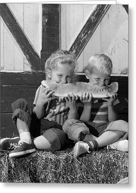 Boy And Girl Sharing Watermelon, C.1960s Greeting Card by H. Armstrong Roberts/ClassicStock